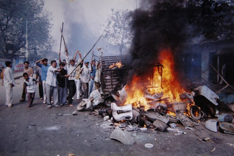 actual historical example of communal violence in ayodhya india